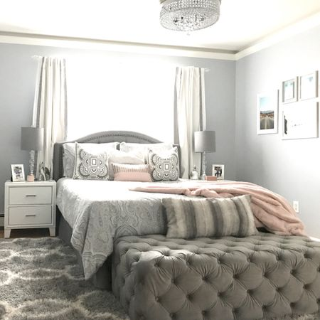 Bedroom decor, white nightstand, grey tufted bench, grey upholstered bed, bedroom inspiration, modern bedroom home decor. Fandolier   You can instantly shop my looks by following me on the LIKEtoKNOW.it shopping app   #LTKfamily #LTKstyletip #LTKhome