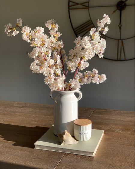 Walmart vase, Walmart candle, amazon cherry blossoms creates a simple neutral centerpiece http://liketk.it/3kTDl #liketkit @liketoknow.it #LTKunder50 #LTKhome #walmarthome #neutraldecor