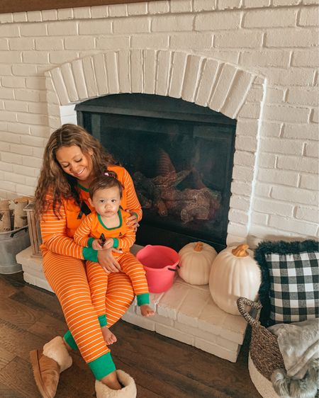 Sweet & Spooky fun with my mini 🎃🎃 She may not love taking photos with me anymore but she loves her pumpkin jammies! Tip: give your toddler the clicker for the tripod, it's most likely the only way to get a family pic 😂😅   Matching family jammies are stocked! Linking the exact jammies and my pumpkin decor here: #halloween #familypajamas #ltkfamily #liketkit #halloweenspirit #targetstyle #targetfinds #mommyandme #matchingfamily #familymatching #mamaandme #whitepumpkins #realmomstyle  #mommyblogger #toddlermomlife #toddlermom #ltkholiday #ltkseasonal #twinning #pumpkinseason #spooky #spookyseason #fauxpumkins #matchymatchy #toddlersofinstagram #clevelandblogger #falldecor