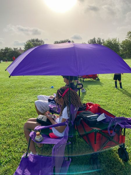 The Texas 🥵Heat is on! We added umbrellas to our chairs to block the sun.  These Academy Sports & Outdoors Clamp-On Umbrellas work great. #Umbrella #SportsChairs #Soccer #Summer @academy  #LTKfamily #LTKkids