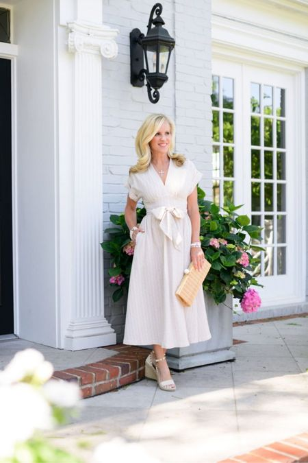 Don't wait to pick up this gorgeous mid length beauty that is part of my recent post on Best Maxi and Midi Dresses for Summer. I love that it is seersucker material and the fit is TTS! I am wearing XS.  #LTKshoecrush #LTKitbag #LTKstyletip
