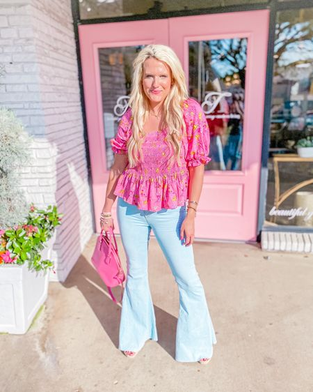 Pink and yellow puff sleeve floral blouse Walmart - size L, runs big so size down! Walmart fashion  Buddy love light wash flare jeans size 27/28  Pink wedges TTS  Kate spade purse Kendra Scott necklace, summer outfit, trendy outfit, summer blouse http://liketk.it/3h9ny #liketkit #LTKDay #LTKunder50 #LTKstyletip @liketoknow.it