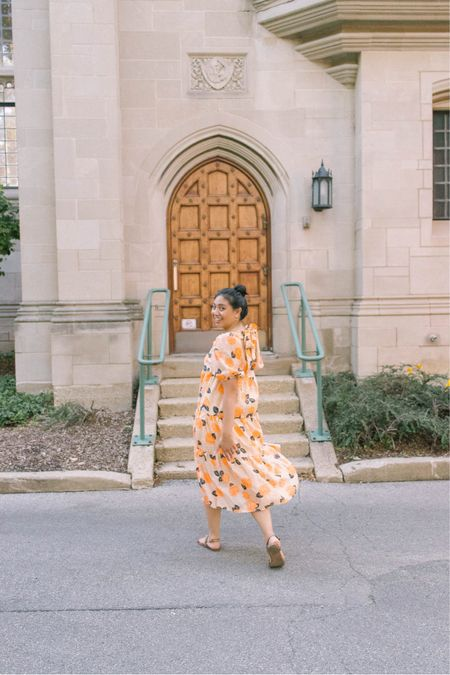 This fruit print dress is a tiered midi dress with puff sleeve and a bow detail in the back. It fits true to size and a great summer dress option // puff sleeve dress   #LTKSeasonal #LTKstyletip