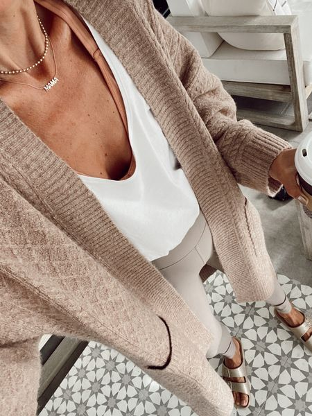 Cable long cardigan (currently 30% off, oversized fit)  Tan leggings  White bubble tank  Two banded sandals  For a fall school drop off outfit   #LTKstyletip #LTKsalealert