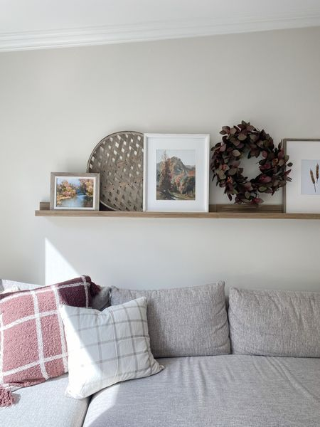 I changed up my ledge shelf for fall and I think it's so cute! I tried something new this year and added a wreath which I love! It brings in a pop of color and a contrasting texture to the space.   #LTKSeasonal #LTKhome