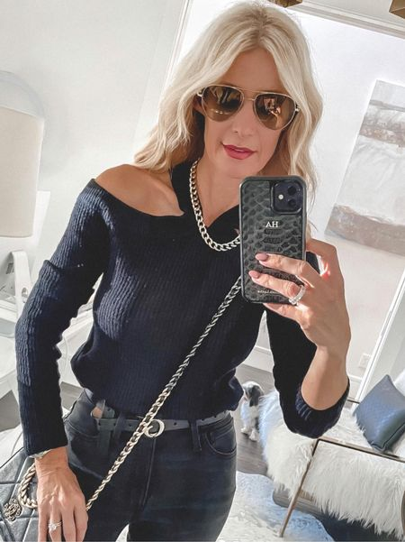Love this chic and edgy under $100 sweater! It runs tts I'm wearing an xs 🖤  Follow my shop @soheatherblog on the @shop.LTK app to shop this post and get my exclusive app-only content!  #liketkit #LTKunder100 #LTKstyletip #LTKunder50 @shop.ltk http://liketk.it/3pheS