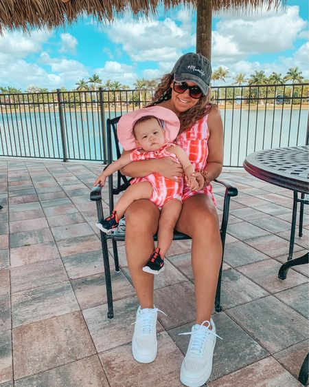 Tie-dye may come and go, but twinning is always trending 🥰 #mamaandme Found these little mommy and me tie-dye romper outfits and they're perfect for a beach vacation or this summer. Super soft and together they're under $30 🙌🏼 I swear Ellie is more excited about it than she looks 😂 Shop your screenshot of this pic in the @liketoknow.it app here @liketoknow.it.family  http://liketk.it/3jSiM  #liketkit #minime #matchingfamily #patpat #mamaandme #mommyandme #traveloutfit #beachvacation #babygirl #twinning #tiedye #romper  Tie dye. Tie-dye. Romper. Summer outfit. White sneakers. Mom hat. Baby girl outfit. Swimsuit coverup. Baby girl fashion. Beach outfit. Vacay style.
