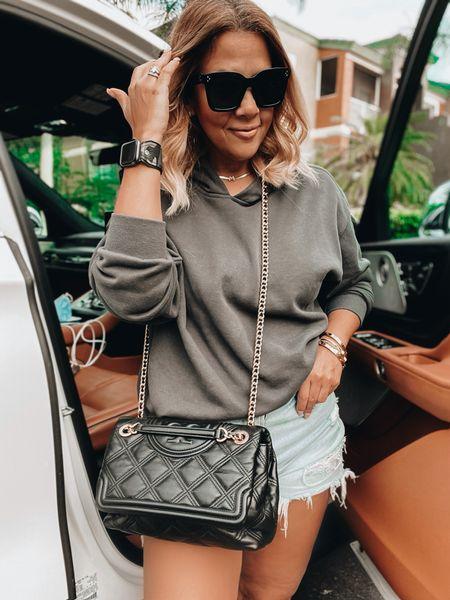 Cropped hoodie, cutoff denim, Tory Burch bag, quilted bag, oversized sunnies, Apple Watch band, camo watchband, gold choker, golden goose sneakers   #LTKstyletip #LTKunder50 #LTKunder100