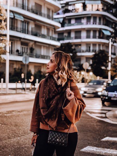Brown sweater, j crew sweater, fall sweater, Louis Vuitton scarf, Louis Vuitton shawl,Chanel WOC, Chanel bag, knee boots, faux leather leggings   #LTKeurope #LTKSeasonal #LTKtravel