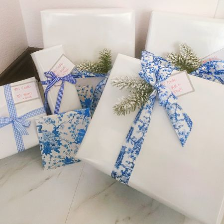 Christmas wrapping in classic chinoiserie chic style ❄️💙🤍 I bought thick high quality white wrapping paper from Amazon, along with this preppy blue gingham ribbon, and other affordable holiday wrapping goodies! Most items ship amazon prime one day 🙌 . .    http://liketk.it/33BRf #liketkit @liketoknow.it #LTKgiftspo #LTKhome #LTKunder50 @liketoknow.it.home  Christmas gifts, holiday wrapping, gift wrap, ribbon, blue and white, classic Christmas, chinoiserie, holiday decor, gifts, presents, gift tags