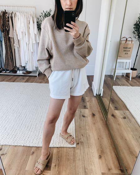 Neutral loungewear. White loungewear. Neutral slides.  Sweatshirt- Barley xs on sale! Shorts- BP xs Sandals- Freedom Moses 4/5  http://liketk.it/3idi2 @liketoknow.it #liketkit #LTKsalealert #LTKshoecrush #LTKunder100