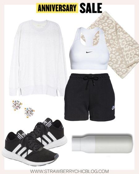 Athleisure look featuring white Nike sports bra and athletic shorts.   #LTKfit #LTKstyletip #LTKsalealert