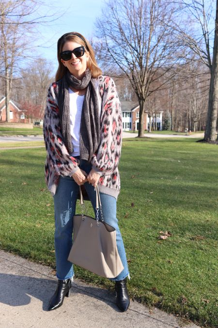 Finally some sun in Northeast Ohio! I am head over heels for the touches of pink in this cozy, leopard print, cardigan sweater - a Christmas gift this year. Same for the updated jean profile, a mid/high waist demi crop boot cut denim in a light/medium wash called Fleetwood. Of course topped off with my Kara Mac Boho boots (worn with the silver heels today), and a grey scarf and handbag. So excited to be out without a coat on! http://liketk.it/35COJ @liketoknow.it #liketkit #LTKNewYear #LTKstyletip #LTKsalealert #LTKunder100 #LTKshoecrush Shop your screenshot of this pic with the LIKEtoKNOW.it app