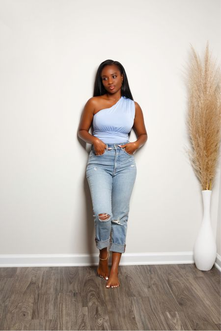 Comfort is key! From the soft bodysuit to the relaxed denim fit. I'm obsessed with this @Express look!   #liketkit @liketoknow.it http://liketk.it/3lmTV