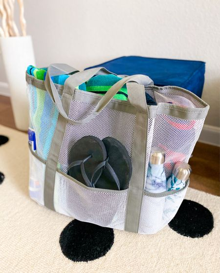 What's in my beach bag         Amazon beach bag with pockets - mesh so sand doesn't get trapped inside - comes in other colors     Amazon finds, family vacation , beach bag , pool bag #ltkkids  #LTKitbag #LTKtravel #LTKfamily