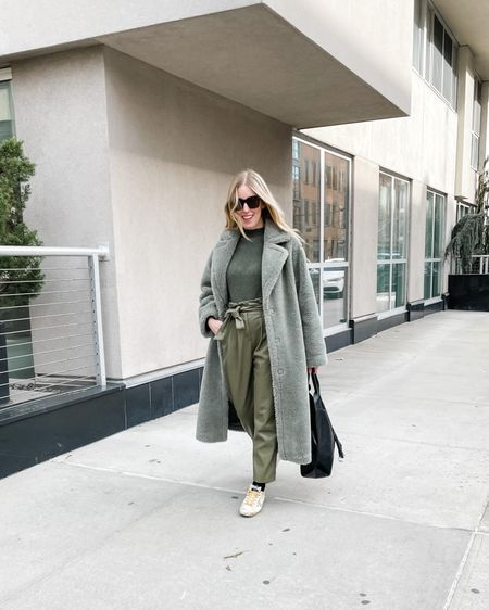 When you finally get to put on an outfit and see humans, you have to document it.   STYLING TIP: If you forgot how to how to put an outfit together that doesn't include sweats, try a foolproof monochromatic look. I'm really into these shades of green — green symbolizes renewal and growth (things I'm looking for in 2021!). 💚  🌟I dare you to try this out this week (even if it's head to toe in sweats lol) and tag me with the hashtag below if you try this styling trick out yourself🌟 #ColorStylingChallenge  My look is via @renttherunway (use my code RTRLIZT) but you can also your screenshot of this pic with the @liketoknow.it shopping app http://liketk.it/36SHT #liketkit #LTKSeasonal #LTKunder100