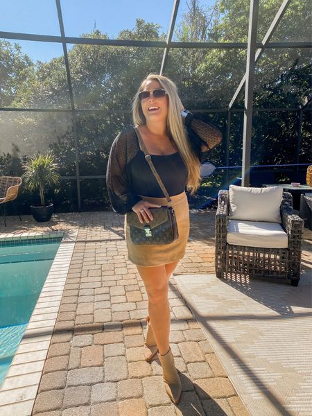 Wearing medium in top tts Wearing medium in skirt tts Shoes run small I went up .5 Fall fashion  Fall outfits  Florida outfits Warm weather fall outfits Brown camel suede skirt Black bodysuit Lace bodysuit  Long sleeve bodysuit Pink lily boutique Fall outfit ideas   #LTKcurves #LTKworkwear #LTKunder100