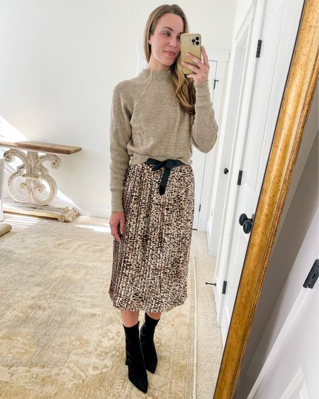 Fall Essentials Outfit wearing Free People mock neck sweater (old, similar linked), Banana Republic leopard skirt (size down), Isabel Marant belt (similar, less expensive linked) and Steve Madden booties (old, similar linked).  For more fall wardrobe essentials and simple fall outfit ideas mixing and matching them, visit natalieyerger.com!  #thanksgivingoutfits #thanksgivingoutfit #fallskirt #pleatedskirt