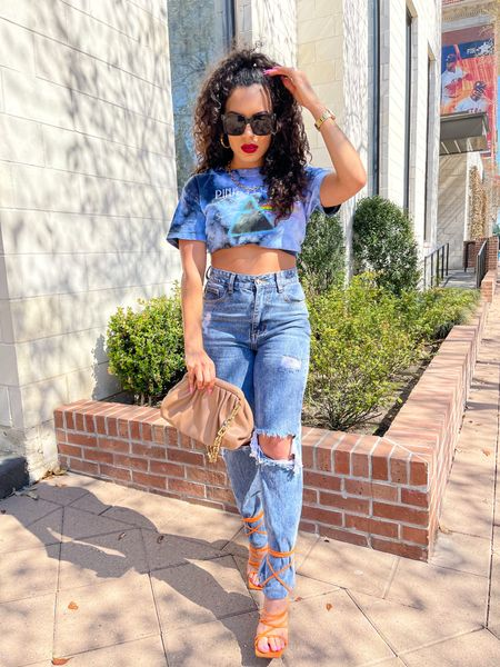Linked this graphic t-shirt from, black oversized sunglasses, orange strappy heels, nude bag as well as some dupes for my jeans and gold chain necklace 🧡💙 http://liketk.it/3di1i #liketkit @liketoknow.it #LTKunder50 #LTKshoecrush #LTKsalealert