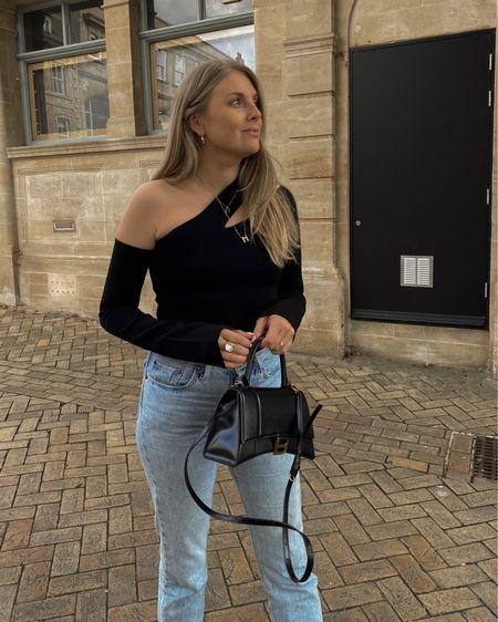 FARFETCH 10% OFF CODE SC10YT 🙌🏻 nanushka black cut out top , balenciaga bag, Prada creepers, Levi's jeans @liketoknow.it #liketkit http://liketk.it/3nZTu #LTKsalealert #LTKeurope #LTKstyletip