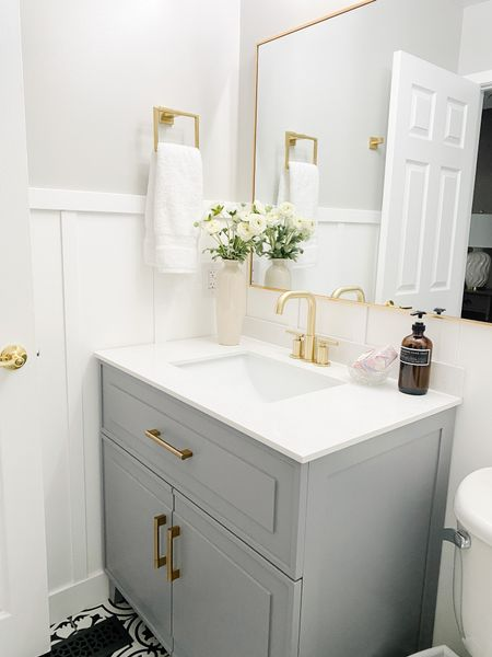 Love this gray vanity with gold hardware for a small bathroom.  Small bathroom, gray cabinets, gold faucets, gold hardware, bathroom decor, bathroom style  #LTKhome
