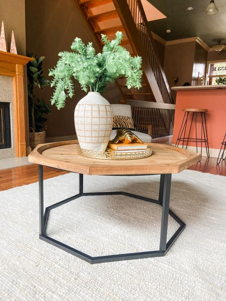 The wood and metal coffee table works great in this traditional loft living room.  #coffeetable #livingroom #homedecor #coffeetablestyle #decorideas    #LTKhome