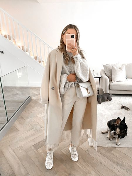 Comfy smart casual  This Mango wool fringe coat was one of my best finds this year!  Knitwear, neutral outfit, wool coat, fringing, YSL, Chloe sneakers, smart trousers