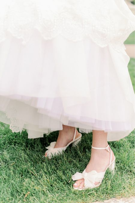 The best ivory wedding shoes for an outdoor wedding. These Loeffler Randall shoes with a block heel and bow are worth every penny and soooo comfortable! I want a pair in every color!  #LTKstyletip #LTKwedding