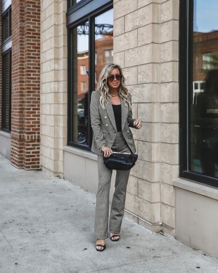 Houndstooth power suit! This vibe is so killer for the office..I swapped out my pants for jeans Friday night and wore it to dinner Sz xs in blazer( I like them more fitted so I size down one) Bodysuit Sz small Dress pants flare leg Sz xs Shoes tts Sz 8   #LTKstyletip #LTKunder100 #LTKworkwear