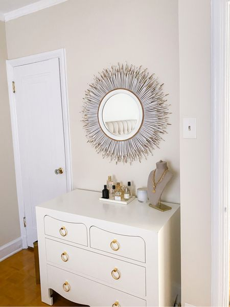 My Horchow mirror is currently 30% off! This porcupine quill mirror makes such a statement and adds so much texture to the room. Also linking my Bungalow 5 dresser, white lacquer gray, candle, and a similar necklace bust.   #LTKsalealert #LTKhome