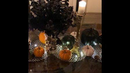 Halloween tablescape you can copy right now! Just add some white, orange and black pumpkins (I got all these fresh this year but also linked some faux options) along with old brass candlesticks, candles, twinkle lights and faux black flowers and voila! #halloweendecor #halloweenstyle #homedecor #falldecor #fallstyle #polishedprofessionals  #LTKSeasonal #LTKhome #LTKHoliday