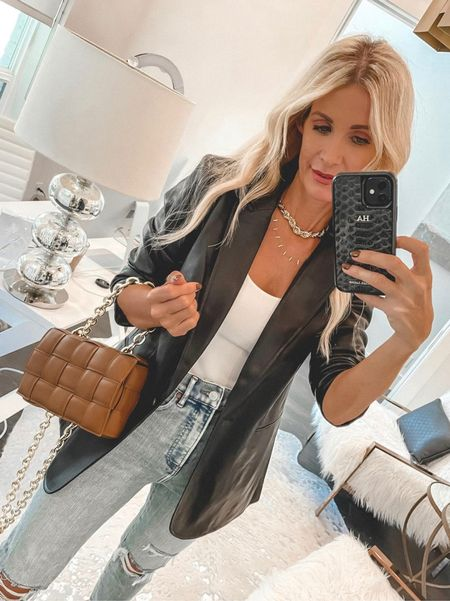 Obsessed with this black faux leather blazer and you won't believe the price!! It runs tts, I'm wearing an XS.   Follow my shop on the @shop.LTK app to shop this post and get my exclusive app-only content!  #liketkit #LTKitbag #LTKstyletip #LTKunder100 @shop.ltk http://liketk.it/3nuvD