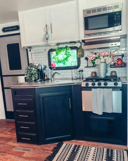 Here a little before and after Of the kitchen in the #traveltrailer There's a few touch ups needed and eventually I'll get around to putting different counter tops in but for now here it is. I'm so happy with how it's turned out so far! Everything is linked on LIke to know it, but I'll post it up in my stories too :)  http://liketk.it/2Updc #liketkit @liketoknow.it #StayHomeWithLTK #LTKunder100 #LTKhome