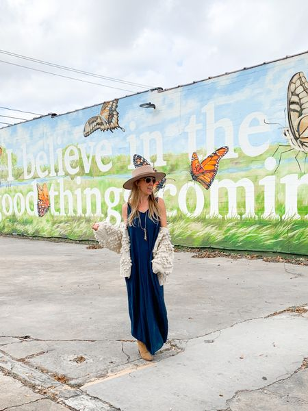 Navy blue maxi dress, chicwish white cream chunky knit sweater, tan fedora hat, tan ankle cowboy boots, brown booties   #LTKNewYear #LTKstyletip #LTKunder50