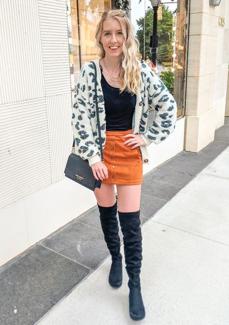 The One Skirt You Need This Fall - Style 1. I paired this suede skirt with a black tank top, a white leopard cardigan and black over the knee boots. A black crossbody purse and gold jewelry completed the look. See other ways to style this skirt on my LTK page.   #LTKSeasonal #LTKstyletip #LTKunder50