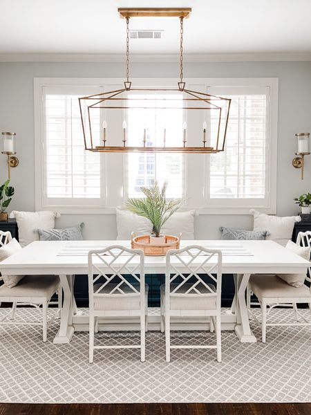 Coastal inspired breakfast nook Dino g room eat in kitchen.   Chinoiserie chippendale chairs. Coastal rug. Blue and white decor. White table. Faux Palm plant. Summer decor. Summer style. Summer dining. Summer decorations.   #diningroom #coastaldecor #summer #summerdecor #homedecor     #LTKSeasonal #LTKhome #LTKstyletip