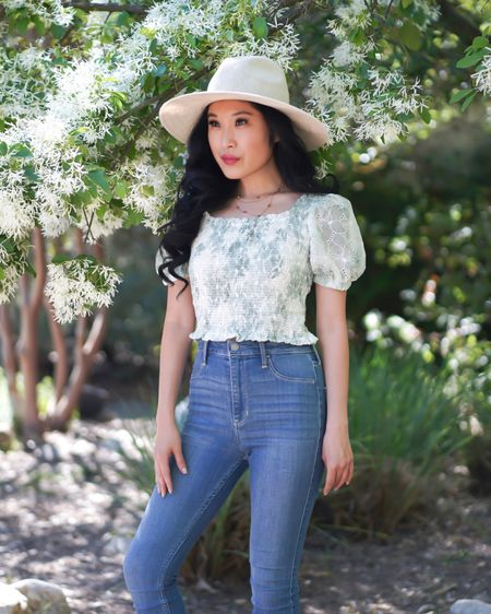 Spring with ASTR white and green puff sleeve crop top! Pair with your favorite medium wash high-waisted jeans from Hollister and white hat! I love this flower necklace from Free People.  http://liketk.it/3eh4F #liketkit @liketoknow.it