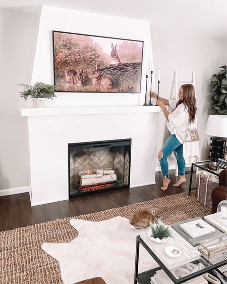 The fireplace of my dreams is DONE + would you believe that hanging above it is a TV?! 😱 SWIPE for the before! I think one things for sure...bun approves. 🐰  The part I'm most excited about is that gorgeous @dimplex_northamerica Revillusion fire-box with the birch log kit! 😍 I have always loved herringbone fireplaces and this one checks all of the boxes. I cannot wait for this fall + winter to cozy up next to it and decorate this space. Next on the list: built-ins on either side and new furniture. Stay tuned!! 🤍  Head to my story to see the full process + shop the entire RBF collection with the link in my bio. #electricfireplace #dimplex #sustainablefireplace #interiordesign #homedecor #dimplexna   http://liketk.it/3gCEQ #liketkit @liketoknow.it
