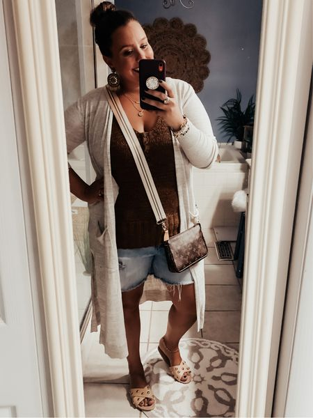 I'm loving these cooler temps! It's the perfect time to mix summer and winter pieces to make the perfect transition outfits! I finally got to wear these cut sandals I snagged at the Beautifully Wilde Boutique sale! They fold up so you can pack them easily for trips! Tank- Target Cardi- Nordstrom Shorts- Old Navy Shoes- Beautifully Wilde boutique   #LTKsalealert #LTKshoecrush #LTKSeasonal