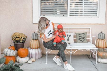 mommy and me Halloween matching outfits on our fall porch! I use the same items year and after to decorate our porch for both Halloween and the fall seasons. I love that these pumpkins nest in one another for storage and these outdoor pillows are the cutest! http://liketk.it/2VCK4 #liketkit @liketoknow.it #LTKhome #LTKfamily #LTKunder50 @liketoknow.it.family