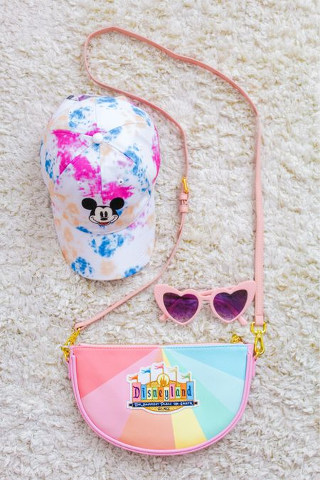 Disney DIY patch tutorial! Make your own custom Disney (or non Disney!) bag or pouch! Travel accessories, crossbody bags, and totes! Anything! This super easy tutorial is up on karascupoftea.com! Also sharing this cute tie dye Mickey baseball hat & my signature PINK heart sunnies!   #LTKfamily #LTKtravel #LTKcurves