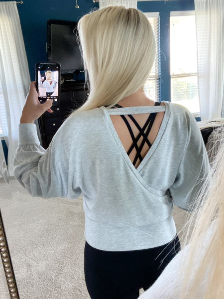 This wrap front sweatshirt is my favorite find from the #Expresssale! It's so incredibly comfy and cute PLUS it's on #sale for $45 (comes in 4 colors). I love the detail of the back, too    #LTKsalealert #LTKunder50 #LTKSeasonal