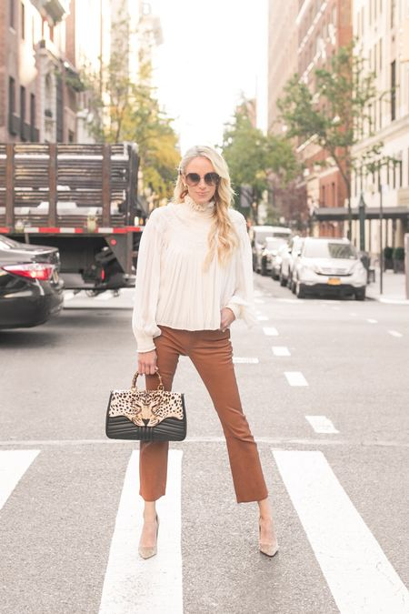 My thoughts on the cropped pant have never been positive, as in I couldn't pull them off. But by styling them with a true heel, I finally got the confidence to step out the door in them.   These leather cropped (and flared!) pant by are so perfect for a day or night out as we SLOWLY transition to Spring 🖤 http://liketk.it/2JtU7 #liketkit @liketoknow.it   Photo Cred:
