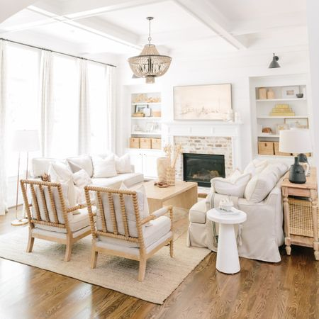 Furnishing your living room should be high on the priority list when you first move. Make sure your spaces make you happy and you stay true to your style! I love neutrals so I kept my couches, tables, and chairs white/tan and I can add seasonal accents as needed 🤍 http://liketk.it/3iK48 #liketkit @liketoknow.it #LTKhome #livingroom # neutralspace #couch #chairs #chandelier