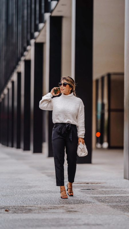 here are ways to dress up a sweater.  Throw on a blazer or jacket, distressed jeans, hi-top sneakers.  wear with denim shorts and sneakers and baseball cap.  wear over dresses or with pencil skirt or maxi skirt.  Wear with jeans, booties, hat, and crossbody bag.  wear with high wait paperbag pants, heels, and clutch.  #falloutfit, #falllook, #fallout, #fallwardrobe, #fallstyle  #LTKSeasonal #LTKunder100 #LTKstyletip