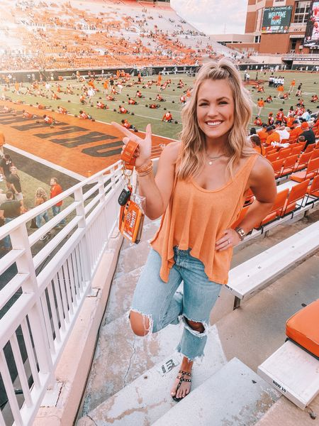 My go-to gameday look! I've worn this flowy orange free people tank two games in a row 🏈🧡