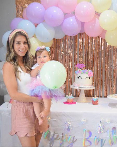 Unicorn 1st birthday party | pink ruffle shorts, white bodysuit, summer headband, baby girl unicorn outfit, unicorn party decor inspo #LTKbaby #LTKfamily #LTKunder50 http://liketk.it/3jyil #liketkit @liketoknow.it