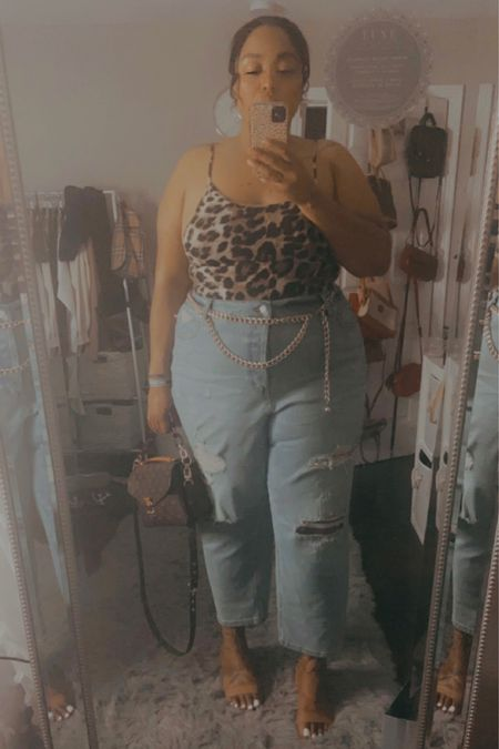 Just a basic plus size date night outfit when you want to look cute but don't feel like putting a lot of thought into it LOL  👚: Plus size leopard print body suit (FN) 👖: Plus size mom jeans (Target) 👜: Louis Vuitton 👡: Nine West  Was finally able to find a PLUS SIZE CHAIN BELT for you guys. They are really hard to find. Also linked the amazing acrylic bag chain from Etsy 💕  #LTKSeasonal #LTKcurves #LTKunder50