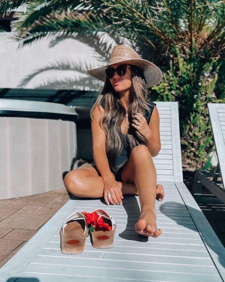 @liketoknow.it #liketkit http://liketk.it/3azRH   One piece swimwear, big beach hat, lack of color, Chloe sandals, sunglasses, swimsuit, Magen Reaves