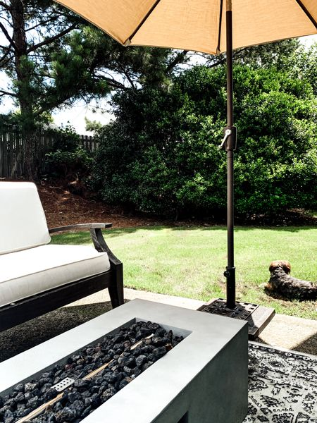 Outdoor living. Small outdoor patio. Sunbella Outdoor Patio Umbrella. Pottery Barn Outdoor Grand Sofa. Rectangular Outdoor Firepit from Target.   Shop this photo below. Follow @lindseyandcoco on @liketoknow.it  to never miss a deal or a sale.    http://liketk.it/3h697 #LTKhome #liketkit #LTKstyletip  #ltkseasonal @liketoknow.it.home